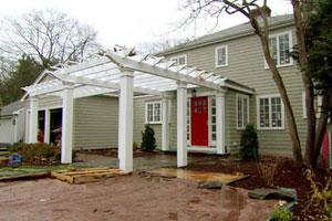 the Auburndale house exterior during renovation, finished pergola