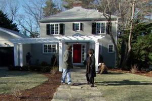 the Auburndale house exterior after renovation, finished pergola and fieldstone walkway