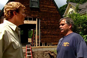 kevin o'connor and tom silva outside the exterior of the concord cottage house project 2003