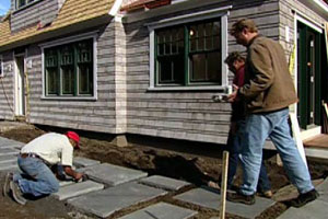 working on the exterior of the 2003 concord cottage house project
