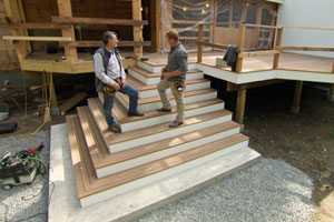 Norm Abram and Kevin O'Connor inspect the deck