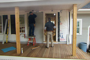 Tom Silva shows Kevin O'Connor how to patch in new clapboards at the Lexington Colonial project