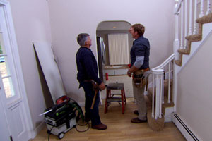 Tom Silva shows Kevin O'Connor how he's turning an arched doorway into one that's squared off