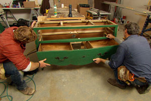 Norm Abram shows Kevin O'Connor how he's turning an old chest of drawers into a vanity