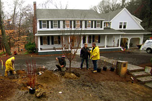 Kevin O'Connor and Roger Cook look over the front lawn plantings