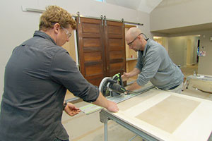 Kevin O'Connor and Matt Allen building the sliding barn door