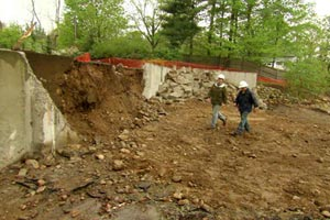 Kevin O'Connor and Tom Silva approach the old foundation at the Weston house project