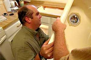Richard Trethewey installing a kitchen sink