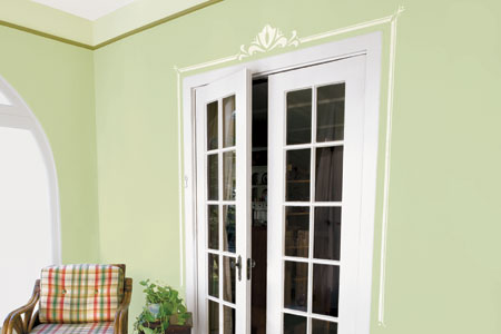 set of French doors with a decorative stenciled border