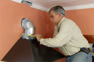 general contractor Tom Silva installs a new range vent hood