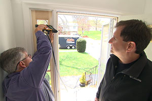Tom Silva replaces a pair of sidelights on a front door