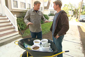 Roger Cook and host Kevin O'Connor patch a lawn with grass seed