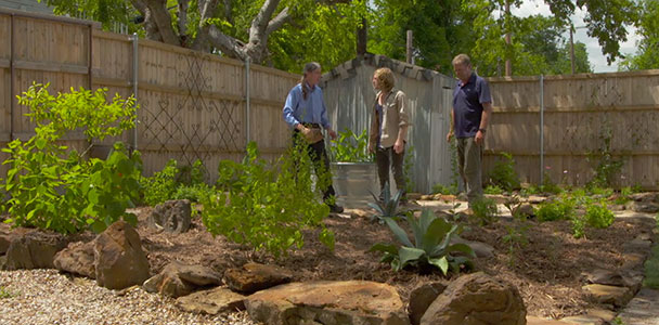 Roger Cook helps plant a garden that attracts butterflies and other pollinators