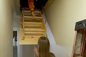Tom Silva removes an old attic staircase and replaces it with a new one