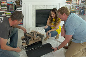 Kevin O'Connor and chimney expert convert a fireplace to a gas log fireplace