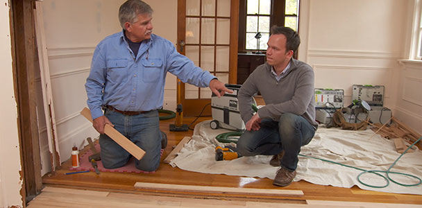 Tom Silva helps a homeowner patch a hardwood floor