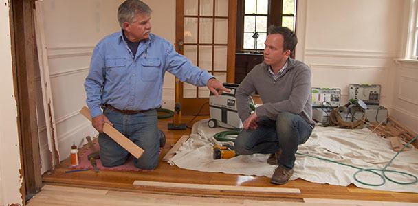 Tom Silva helps a homeowner patch a hardwood floor