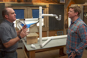 Richard Trethewey explains plumbing traps to Kevin O'Connor