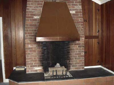 fireplace built on the exterior side of the chimney