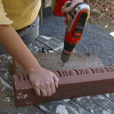 pre-drill holes for screws to turn cornice into garden tool holder